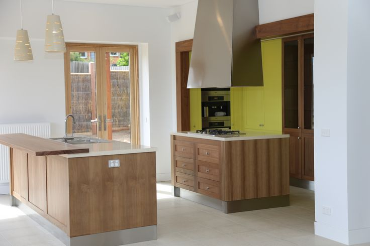 Contemporary hand painted Tasmanian oak kitchen with stone tops and Spotted gum raised island bench