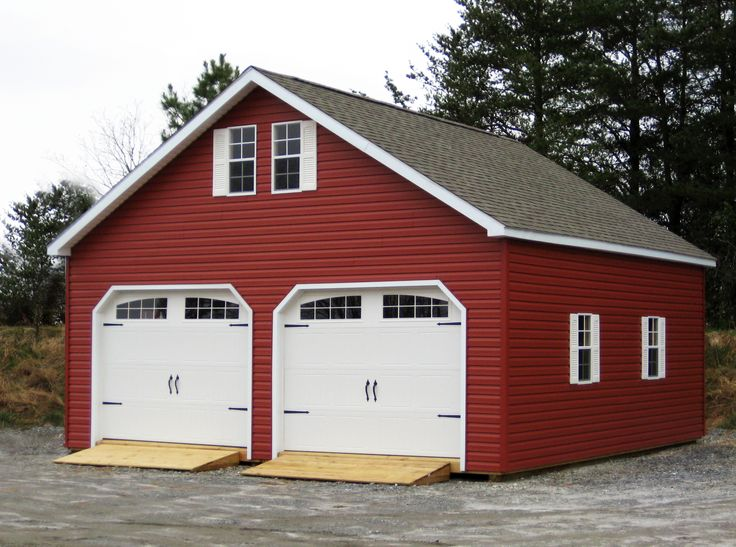 Classy garage with red vinyl siding for Red barn prefab