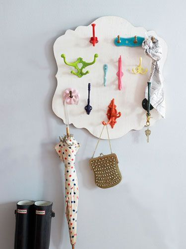 DIY colorful wooden key rack. Kind of a cute idea. It would be more functional if it were long and narrow though.