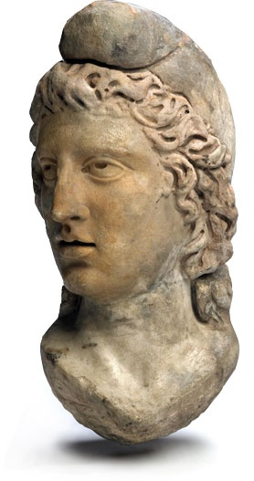 2nd C. From a temple in France. Roman legion Cult head of the god Mithras, a god of light, truth, and honor. He wears the padam on his head which is associated with ancient persians.