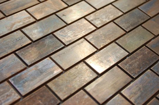 Antiqued copper metallic tile.  This would go in the kitchen as a back splash.