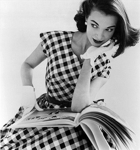 Model: Helen Bunney. Photo: John French. London, 1957 plaid checks black white day dress short sleeves full skirt 50s 60s photo print ad designer vintage fashion