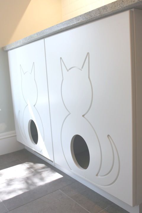Cute doors into enclosed cat food and litter box areas, to keep the dogs out!