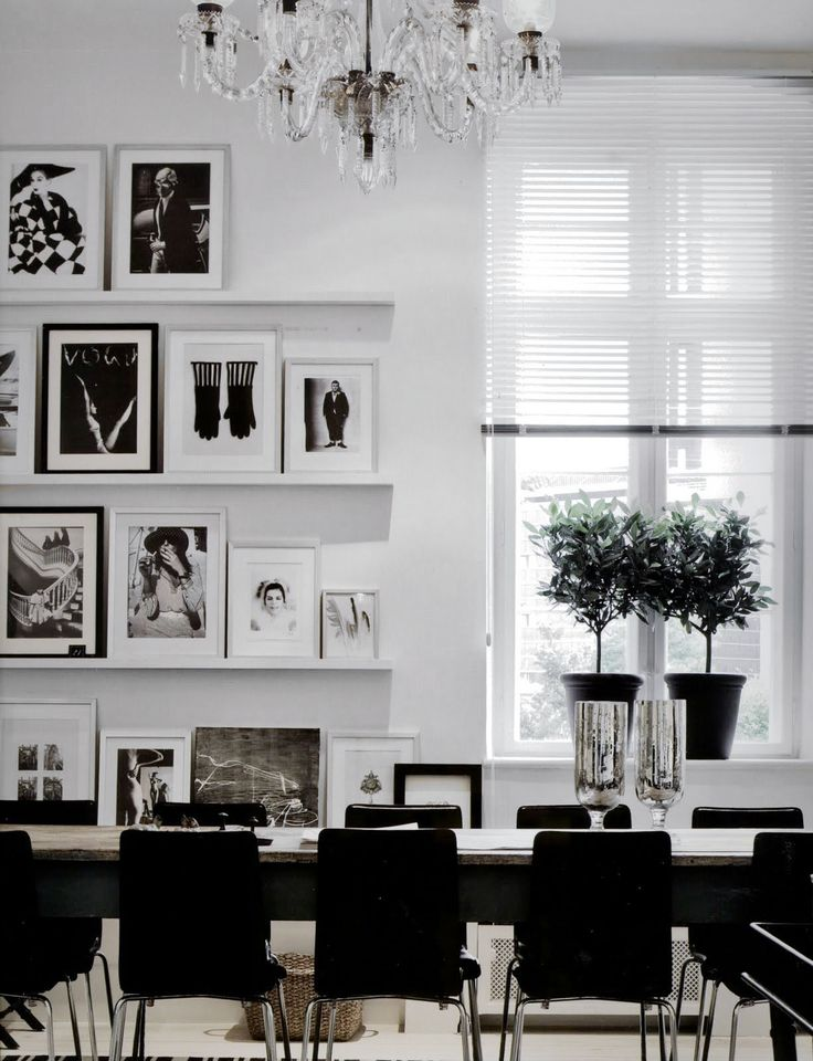 stunning use of picture rails and mix and match frames with black and white photographs black and white office