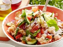 "Panzanella (Stale Bread Summer Entree) : from Debi Mazur's cooking show ""Extra Virgin"".  Good use for all those extra tomatoes and bread..."
