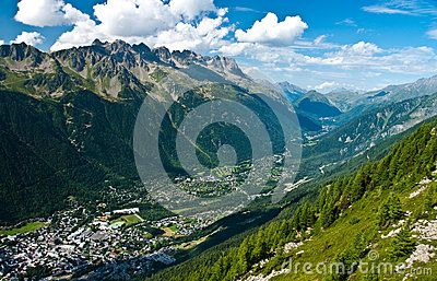 Panoramic aerial view of French city of Chamonix, as seen from cable car going up Aiguille du Midi.
