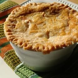 A delicious chicken pot pie made from scratch with carrots, peas, and celery for a comfort food classic.