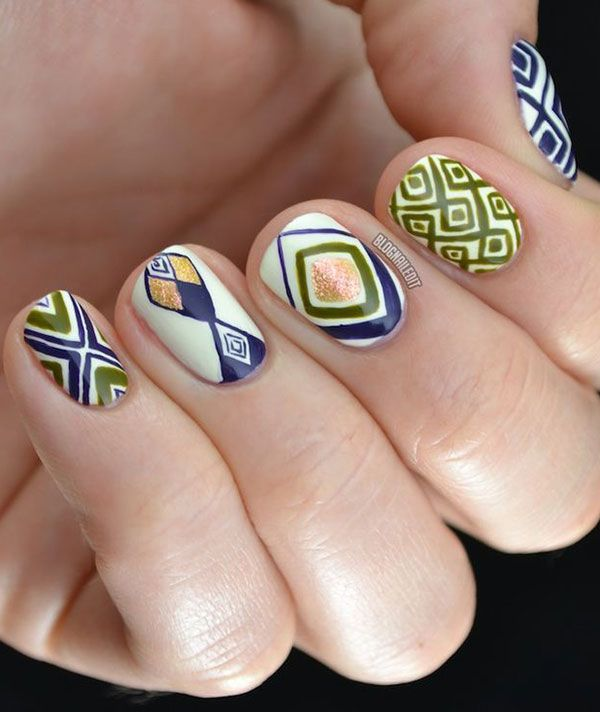 Katy of Nailed It shows off a safari-inspired manicure. This nail design uses lots of earthy tones and patterns. Perfect for summer! #nails #nailart #summernails