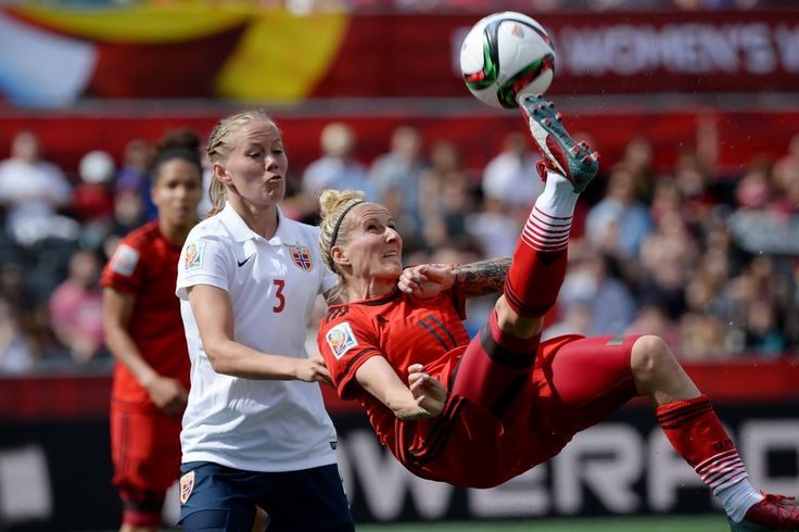 Germany's Anja Mittag, right, kicks the ball as Norway's Marita Skammelsrud defends during a 1-1 tie in Ottawa on Thursday.