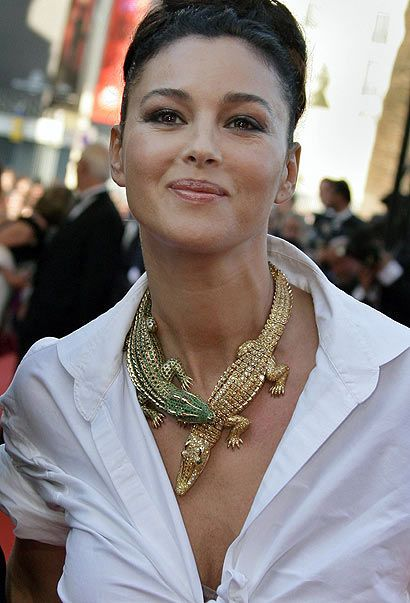 Monica Bellucci wearing the Cartier Croc necklace originally commissioned by Maria Felix. Description from pinterest.com. I searched for this on bing.com/images