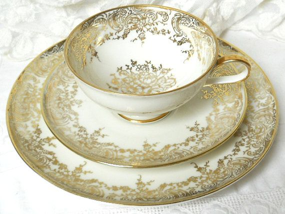 Gorgeous vintage teacup trio with a beautiful gold floral decoration on off white porcelain.  Made by Winterling Roslau, Bavaria, Germany, between 1945 and 1950.  It is in very good condition, no chips or cracks. Please do not put it in the dishwasher!  5  For more vintage teacups visit our shop section: https://www.etsy.com/shop/minoucbrocante?section_id=12193676&ref=shopsection_leftnav_2  For more vintage items please visit our shop: http://www.mi...