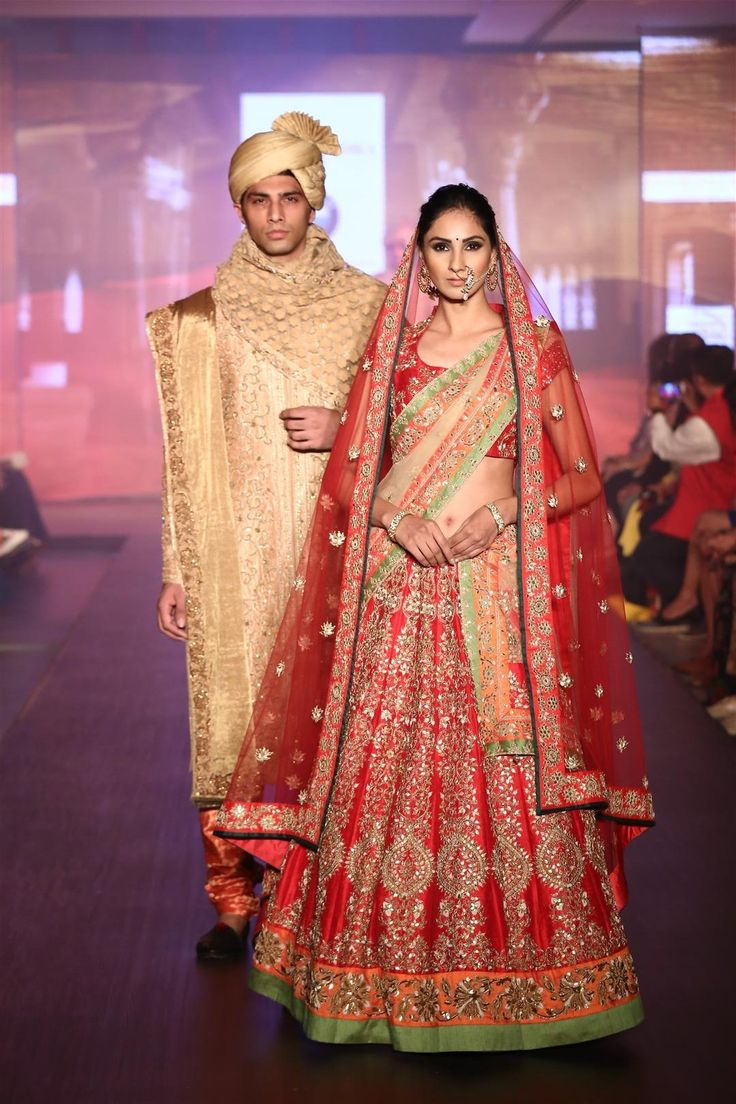 A bright red lehenga paired with a matching cholee, contrasting borders on lehenga and dupatta
