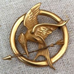 Dana Schneider, owner of Dana Schneider Jewelry, had the responsibility of designing the signature Mockingjay pin for the highly anticipated blockbuster 'The Hunger Games.' #DanaSchneider #TheHungerGames