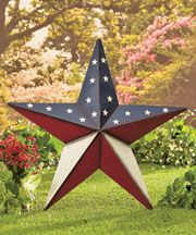 """The versatile design of this 24"""" Americana Star Decor lets you stake it into the ground or hang it up! The large-scale barn star is decorated with an American-themed design, perfect for outdoor use. Use the 7"""" stakes to install it into the ground, or use the included jute rope to hang it. 24""""W x 2-/14""""D x 24-1/2""""H, without stake. Metal. Easy, no-tool assembly required."""