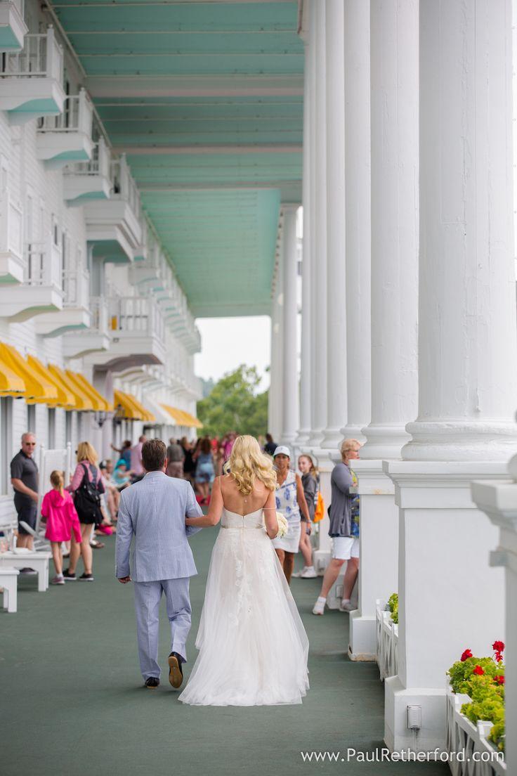 Bride Walking On Grand Hotel Porch Photo