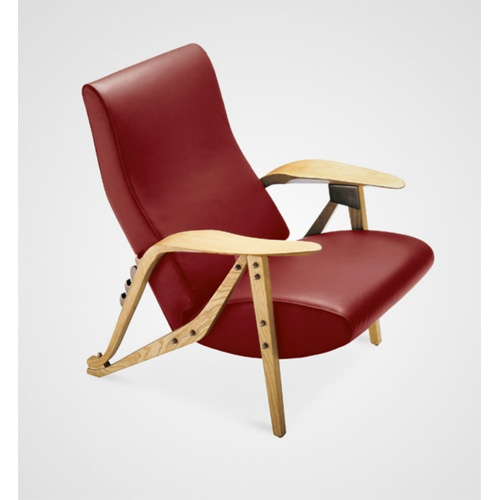 I have this chair called Gilda designed by Carlo Mollino in 1954. Mine is off white. A piece of art.
