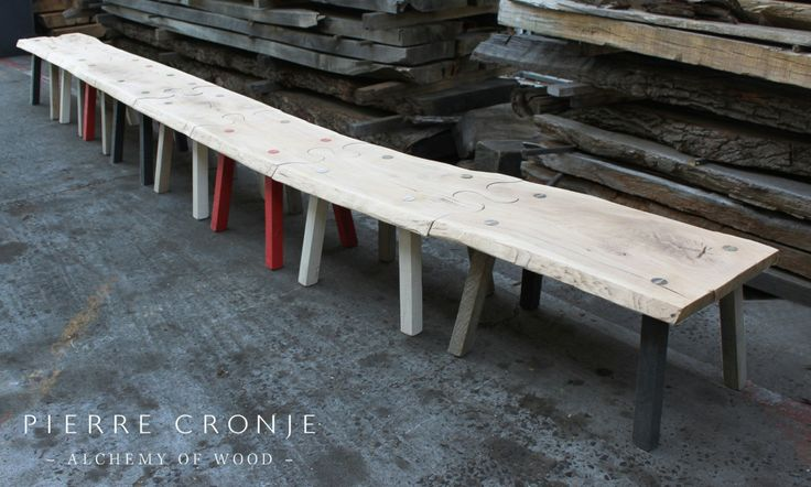 A one of a kind Pierre Cronje Puzzle Bench in French Oak with multi-coloured legs.