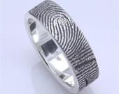 Custom Fingerprint Wedding band with single fingertip whorl inside in sterling silver. $210.00, via Etsy.