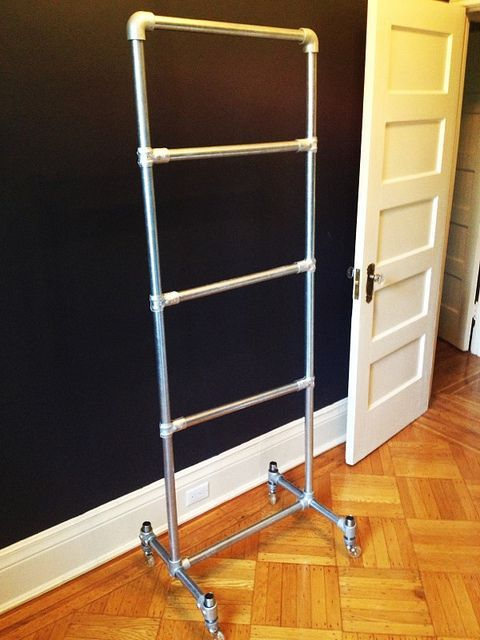 """DYI rolling """"closet"""" for little one made from pipes .. . great idea for bedrooms in old houses with little to no closet space"""