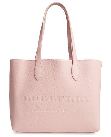 0ecd4f6169ea remington leather tote by Burberry. Clean lines underscore the minimalist  design of a spacious pebbled-leather tote finished with hand-painted edges  and ...