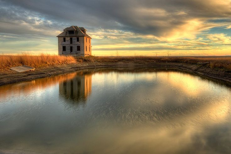 Reflections of the Past - Old brick mansion in Saskatchewan Canada