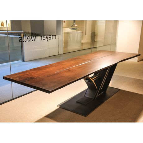 The Rainer is a modern industrial take on the classic dining table. This monumental piece combines a maple top with a steel strip inlay and custom steel base. The custom steel base contrasts with the warm wood and provides a dramatic alternative to the usual pedestal support. This substantial table also makes a wonderful conference table.