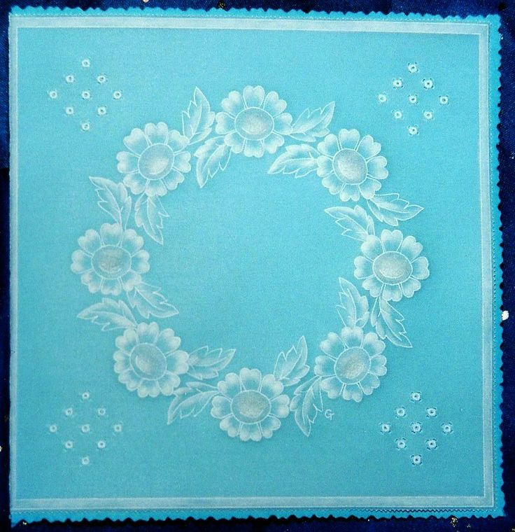 This wreath of embossed flowers would be suitable for a sympathy card.