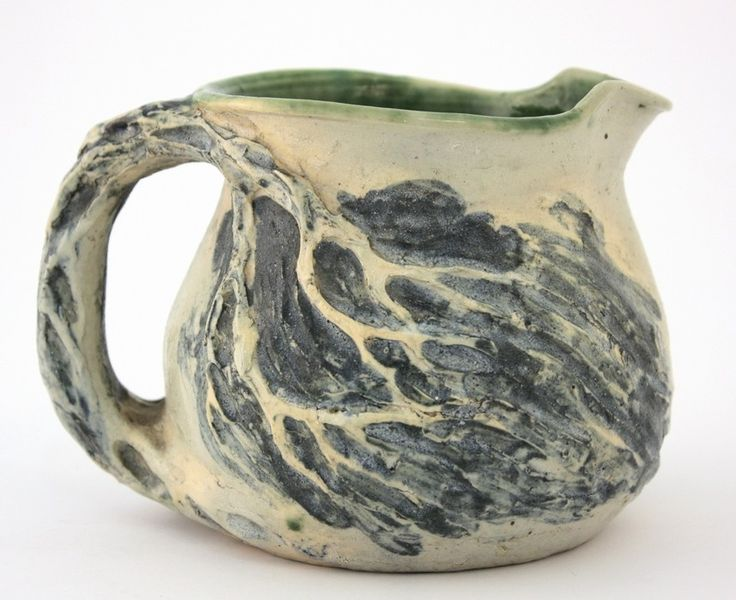 Merric Boyd Pottery jug with windswept landscape design.