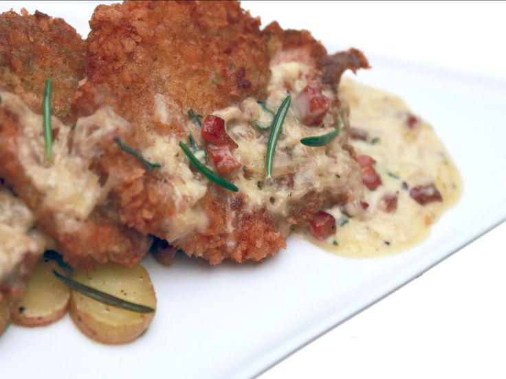 Pan Fried Chicken Thighs with Pancetta Cream over Confit Potatoes recipe from Brad Sorenson via Food Network