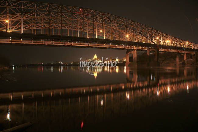 """""""Missouri River Bridge at Night"""" by Chris Wolters Photography, Missouri // The Missouri river bridge HDR taken at night from the Callaway County side.  You can see the lights of Jefferson City Missouri in the background, with most noticeablely, the capitol building. // Imagekind.com -- Buy stunning, museum-quality fine art prints, framed prints, and canvas prints directly from independent working artists and photographers."""