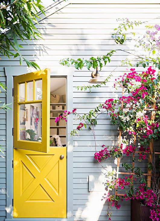 yellow door and pale gray home exterior / sfgirlbybay