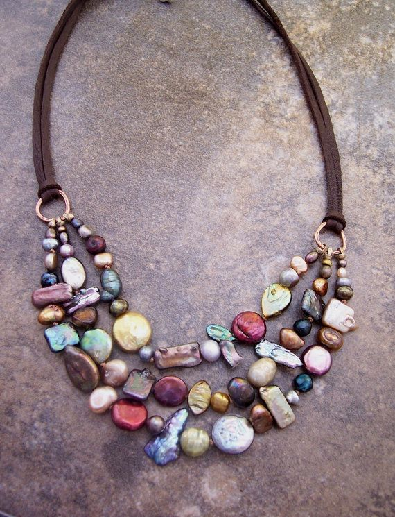 Mixed pearls and leather. Ooak Triple Stranded Fresh Water Pearl by dnajewelrydesigns, $85.00