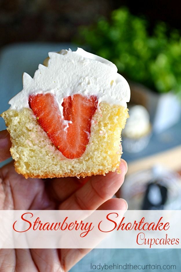 Strawberry Shortcake Cupcakes a dense sweet pound cake filled with a whole strawberry and topped with a whip cream frosting.