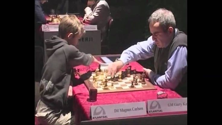 Carlsen 12-year-old Vs. Kasparov The 12 year-old Magnus Carlsen plays World Chess Champion. The body language is remarkable
