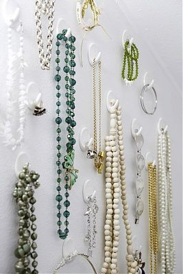 Love this jewelry display of different tiered white hooks.  #jewelry #display