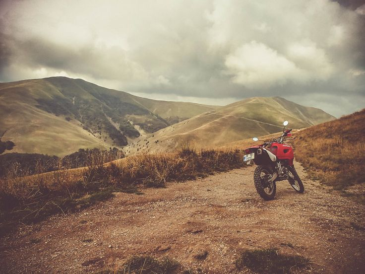 Enduro motorcycle (Honda XR650R) on a short stop by an offroad trail among the hills in the Valea Doftanei region, Romania. Full portfolio: http://the-world-according-to-my-camera.net/ #motorcycle #enduro #offroad #hills #Honda #XR650R