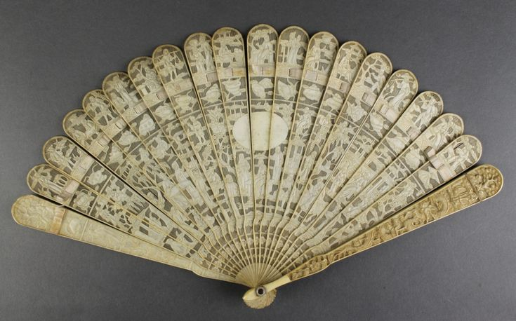 "Lot 758, A early 20th Century carved Cantonese ivory fan decorated with figures in an extensive pavilion landscape with vacant cartouche 7"", sold for £210"