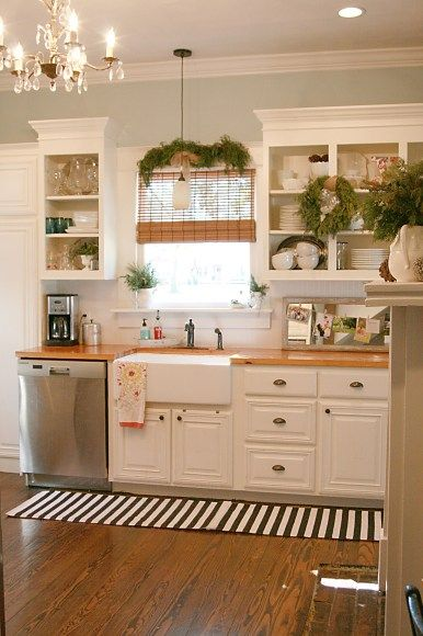 Replace the countertops with dark wood and this is my PERFECT kitchen...everything from the colors to the open cabinets and farmhouse sink