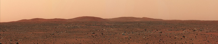 The Columbia Hills range from a distance, taken by the Mars Spirit Rover in Gusev Crater. From left to right: Anderson Hill, Brown Hill, Chawla Hill, Clark Hill, Husband Hill, McCool Hill and Ramon Hill. Jan 2004