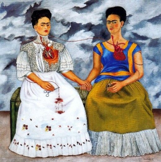 """""""The Two Fridas"""" by Frida Kahlo (1939) This painting was done when she divorced Rivera after returning home from an exhibit of her work in Paris, and depicts the split between her two selves--""""The Two Fridas."""" The woman on the left represents European Frida, while the woman on the right represents Mexican Frida, in traditional tehuana dress. Frida's work is a chronicle of her life. Her paintings are full of honesty and emotion."""