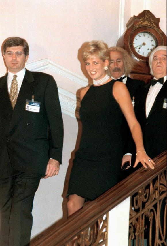 Princess Diana is escorted by Gian Domenico Picco, left, Chairman of the Research Center Pio Manzu', to a gala dinner at the Grand Hotel in Rimini, Saturday, October 12, 1996. Princess Diana was in Rimini to receive an award for her charity activities.