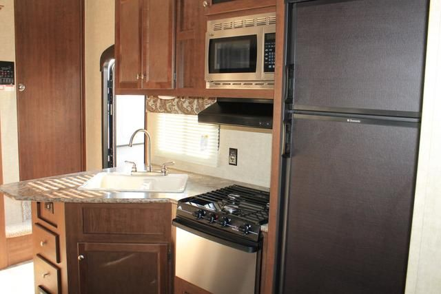 2016 New Keystone Hideout 308BHDS Fifth Wheel in Florida FL.Recreational Vehicle, rv, 2016 Keystone Hideout308BHDS, 15.0 BTU A/C, 15in Spare Tire Kit, 50AMP Service, 6 Gal. Gas/Electric Water Heater, Aluminum Rims, Carbon Monoxide Detector, CHAMPAGNE, Cold Mountain Package, Correct Track, Decor- Cedar, Double door refrigerator, Electric Awning, Exterior Ladder, Hideout Luxury Pkg, LCD Television, Outside Speakers, Platinum Package, Radial Tires, RVIA Seal, Tinted Safety Glass, Winterization…