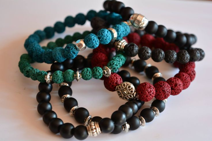 Charm bracelets made of lava stone beads and charms