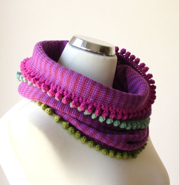Striped knitted cowl scarf in red and purple with colorful crocheted details by rukkola on Etsy. #colorfulscarf # knittedcowl #fashionaccessories