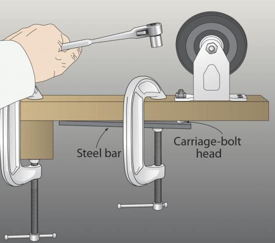 If you've ever had a carriage bolt slip when the square collar tears out the wood grain, here's a solution. Clamp a steel bar or a flat wrench (or a rasp if it's really stubborn) over the bolt head, where shown. The friction on the head gives you enough grip to finish tightening or loosening the nut. —Richard Wood, Appleton, Wis.