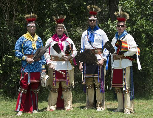 Osage Nation relatives of Maj. Gen. Clarence L. Tinker, dressed in native attire, sing and dance to a song written to Tinker during their annual four day celebration called In-lon-shka held in Pawhuska Indian Village, Okla., June 30, 2013. Tinker was the highest ranking officer of Native-American ancestry and the first general lost in action during World War II. (Photo by Desiree N. Palacios)