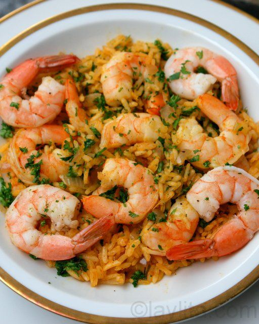 Arroz con camarones or Shrimp with Rice - a traditional Latin dish made with rice cooked in a shrimp broth and sautéed with shrimp or prawns, onions, peppers, tomatoes, garlic, cumin, achiote and parsley.