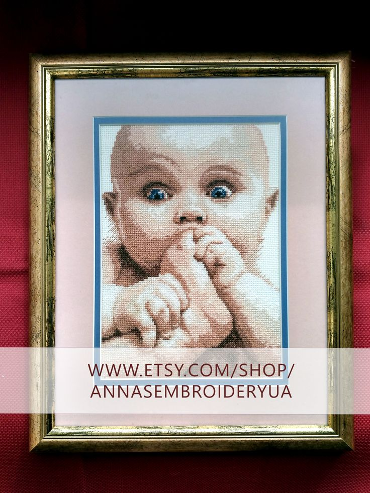 A child. Framed cross-stitch (completed) made by hands. Wooden frames, anti glare glass.