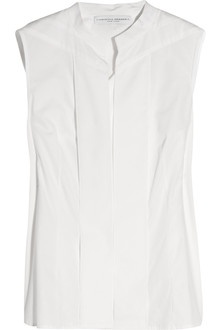 CAROLINA HERRERA White Sleeveless Cotton Shirt Carolina Herrara's beautifully cut sleeveless shirt is a wardrobe essential. Tuck it into a printed skirt or tailored pants for the office, cocktails or a garden party - just add a knit when the temperature cools. Carolina Herrara sleeveless shirt: white cotton, mandarin collar, folded front. Concealed button fastenings through front. 100% cotton. Dry clean