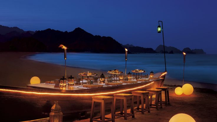 - A boat converted into a table holds the sea's bounty for an extravaganza beach dining experience.